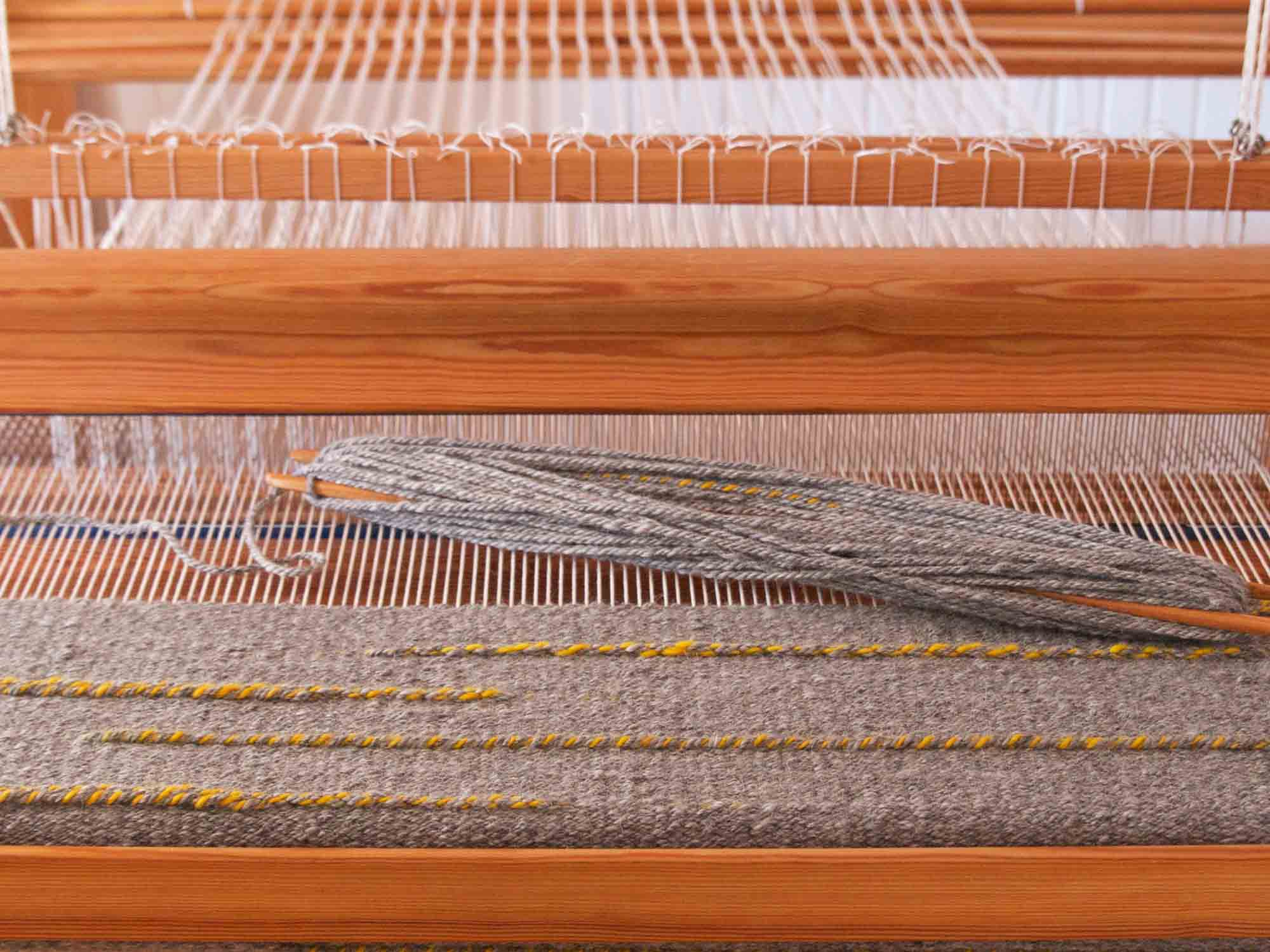 Floor loom, shuttle, wrap and yarn